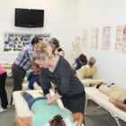 Doctor of Osteopathy students of National University of Medical Sciences practicing techniques in Toronto - July 2014