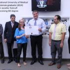 National University of Medical Sciences graduate (2014) Jennifer Pottruff receiving DO degree