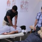 Professor Amir Kazemi teaching osteopathic osteoarticular spinal mobilization to National University of Medical Sciences studen