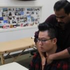 Students practicing osteopathic visceral technique